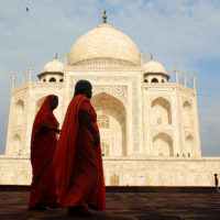 Agra, India- Women dressed in red tour the grounds of the Taj Mahal.