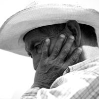 San Cristóbal de las Casas, Mexico- A farmer looks worried as he discusses the fate of his coffee crops during a drought.