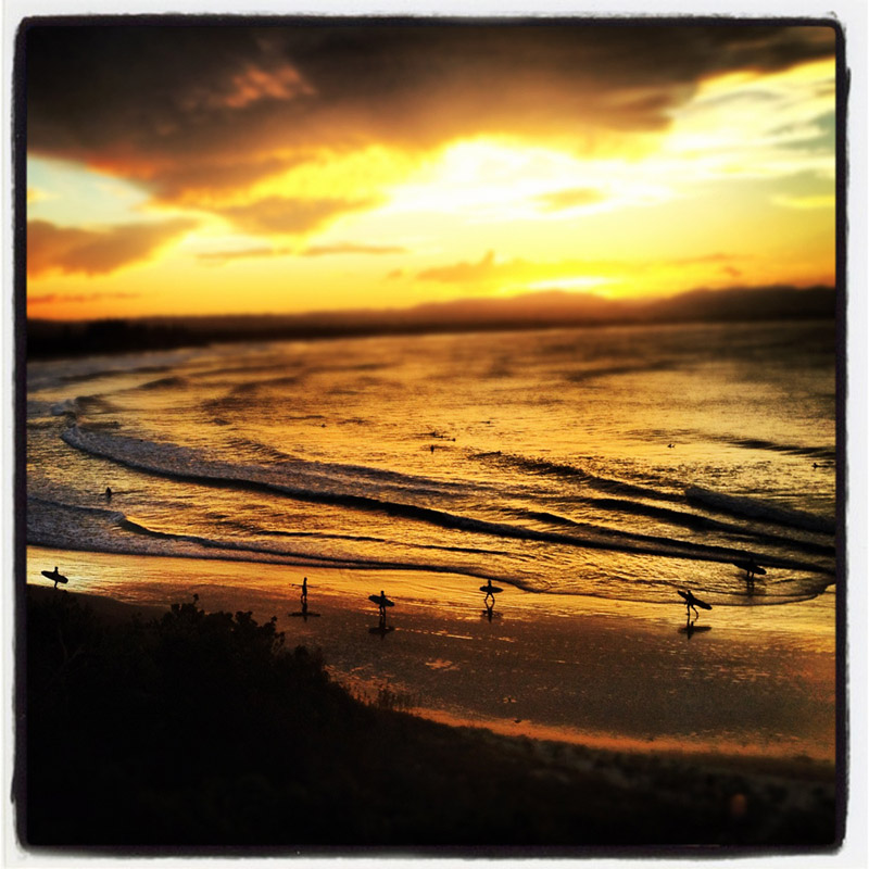Iphone Instagram photo of surfers at New South Wales in Byron Bay Australia at sunset. by Kira Vos (Horvath)