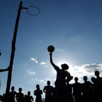 SANTHE, Malawi- A group of teenage girls plays basketball after a long day of endless chores. These few minutes, before the sun sets, is the only time during their demanding days that they get to be kids, laughing and smiling from ear to ear.