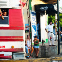 San Juan del Sur, Nicaragua- Two children pop their heads out of a chicken bus bound for Granada. Old school buses are the cheapest and most often form of transportation in Nicaragua although they are extremely dangerous and unreliable.