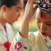 BOUNTIFUL, UT., - Kim Yu-Tin adjusts her headpiece before performing with the Cho Jin-Suk Dance Company, from South Korea, at Bountiful's Summerfest International.