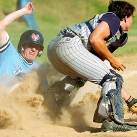 PEABODY, MA., July 24- Peabody's Sean O'Hara, left, slides into home as Andover catcher Tim Hughes field's the ball during the third inning of their Legion playoff game held at Bezemes field. O'Hara was called out on the disputed play.
