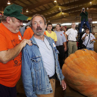 TOPSFIElD, MA., - Dick Wallace, left, congratulatesa shocked Steven Sperry who couldn't believe his eyeswhen his pumpkin weighed in at 1253.2 pounds winning the New England Giant Pumpkin weigh-off at the Topsfield Fair.