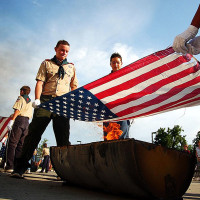 KAYSVILLE, UT., July 16- Thirteen-year-old boy scouts Jessop Boden, left, and Austin Miller retire a flag at the Kaysville Fire Department. Boden organized this flag ceremony, which retired 138 flags, for his Eagle Scout project.