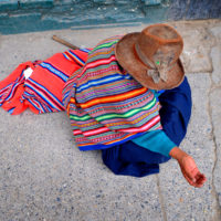 Huaraz, Peru- A woman begs for money on the streets of the popular mountaineering town of Hauraz.