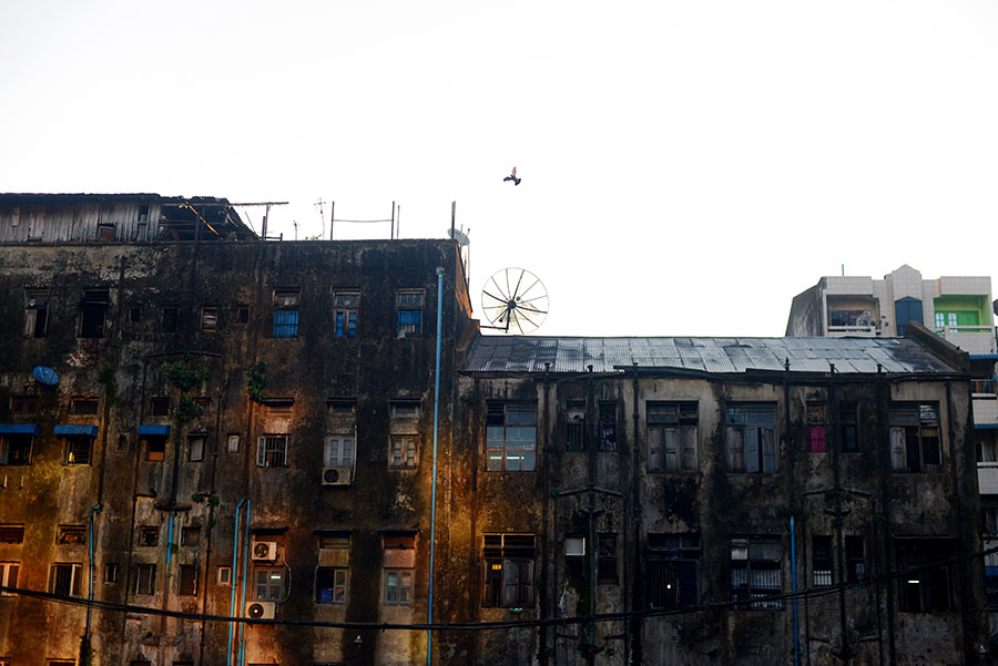 Old, weather-stained buildings of downtown Yangon, Myanmar. - Kira Horvath Photography