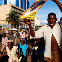 Supporters of the National Resistance Movement celebrate the re-elction of President Yoweri Museveni in the streets of downtown Kampala, Uganda on Saturday, Feb. 25, 2006.