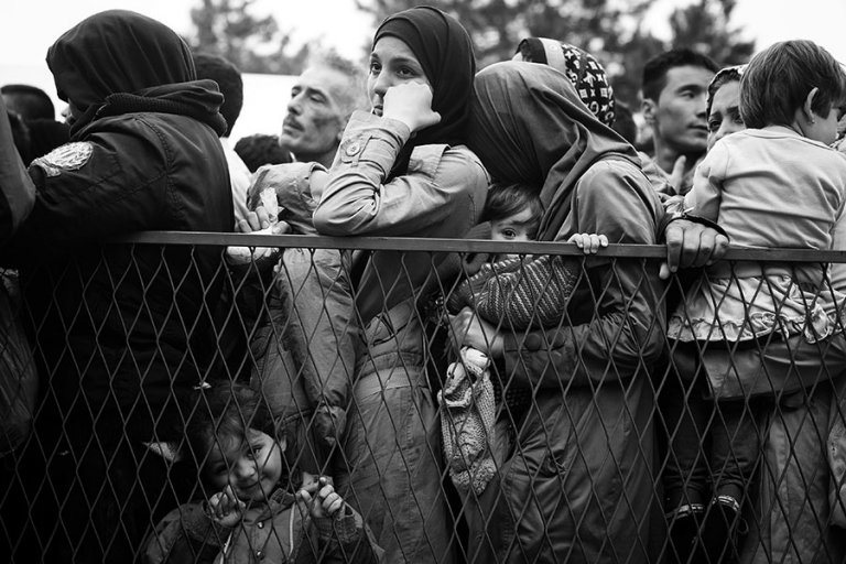 Syrian refugee's line up to wait for donations from the Red Cross at Belgrade, Serbia.  - Kira Horvath Photography