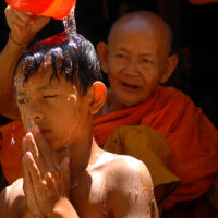 Angkor Wat, Cambodia- A boy is blessed by a monk in the temple zone of Angkor Wat, Cambodia.