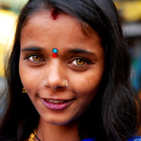 Varanasi, India- Portrait of a young woman with yellow eyes on the streets of Varanasi, India.