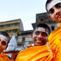 Varanasi, India- Sādhu children wear saffron-coloured clothing, symbolising their renunciation. The sādhu is solely dedicated to achieving liberation, the fourth and final aśrama (stage of life), through meditation and contemplation of Brahman.