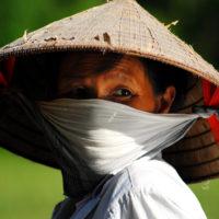 Mekong Delta, Vietnam- Portrait of a boat driver on Vietnam's Mekong Delta.