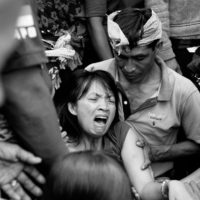 Kedisan, Bali- A mother wails at the funeral for her nine-year-old daughter who died in a drowning accident. In Bali, a person is buried alongside offerings for the gods and gifts from their family. This girl was buried with a scruffy old teddy bear, a box of crayons and a new pink tee shirt.