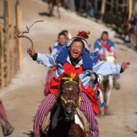 Todos Santos, Guatemala- A man races down a makeshift track during the infamous drunken horse races during All Saints Day weekend in the small mountain town of Todos Santos.