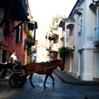 Man with a horse drawn carriage in old town Cartagena, Colombia