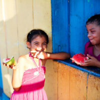 Girls eat watermelon on Isla de Ometepe, Nicaragua