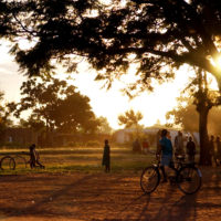 Villagers playing at Sunset in the remote African village of Santhe, Malawi