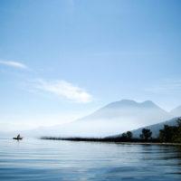 Fisherman with volcano on Lake Atitlan, Guatemala