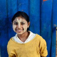 Girl with thanaka in Yangon, Myanmar