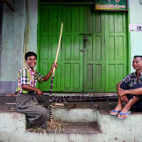 Men preparing sugar cane in Yangon, Myanmar