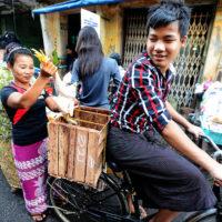 Woman loads chicken on to bike in Yangon, Myanmar