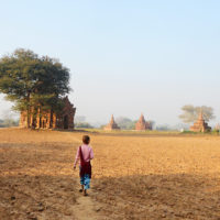 Girl walking through the ancient temple zone in Bagan, Myanmar