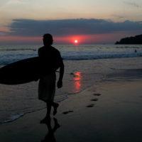 Surfer at sunset in Manuel Antonio, Costa Rica
