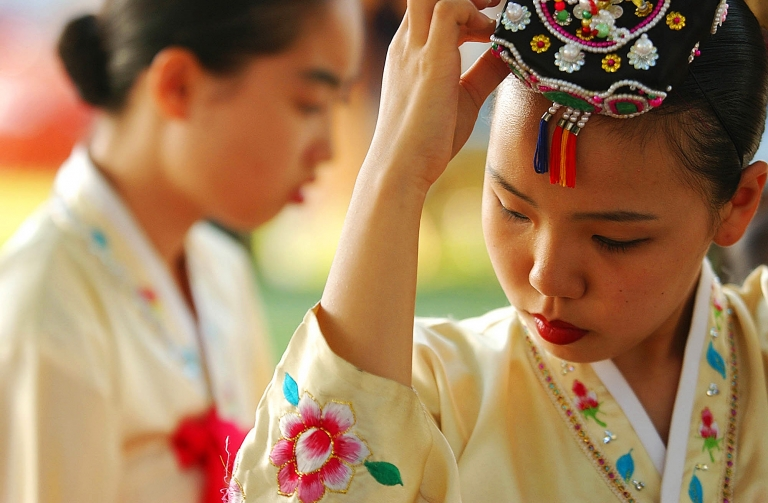 BOUNTIFUL, UT., - Kim Yu-Tin adjusts her headpiece before performing with the Cho Jin-Suk Dance Company, from South Korea, at Bountiful's Summerfest International. Kira Vos Photography